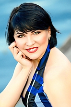 Ukrainian girl Nina,41 years old with green eyes and black hair.