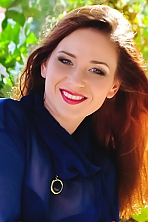 Ukrainian girl Elena,29 years old with green eyes and auburn hair.