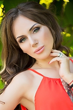 Ukrainian girl Alena,33 years old with brown eyes and light brown hair.