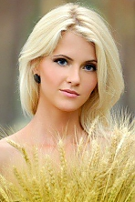 Ukrainian girl Anastasia,23 years old with grey eyes and blonde hair.