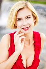Ukrainian girl Vita,48 years old with grey eyes and blonde hair.