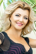 Ukrainian girl Tatjana,43 years old with green eyes and blonde hair.
