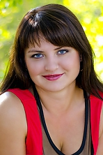 Ukrainian girl Natalia,32 years old with grey eyes and dark brown hair.