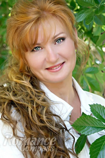 Russian girl Elena,50 years old with blue eyes and auburn hair.