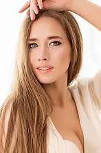Ukrainian girl Anastasia,25 years old with grey eyes and light brown hair.