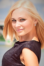 Ukrainian girl Oksana,28 years old with green eyes and blonde hair.