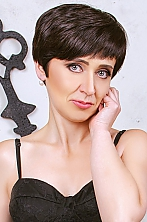 Ukrainian girl Nataly,41 years old with grey eyes and dark brown hair.