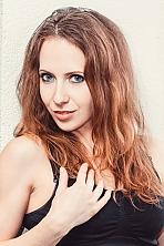 Ukrainian girl Svetlana,28 years old with blue eyes and light brown hair.
