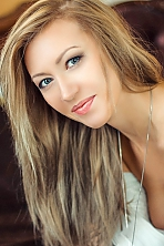 Russian girl Inna,30 years old with blue eyes and blonde hair.