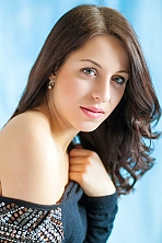 Ukrainian girl Olga,23 years old with grey eyes and dark brown hair.