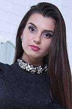 Ukrainian girl Daria,22 years old with brown eyes and dark brown hair.