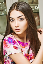 Ukrainian girl Alena,25 years old with green eyes and black hair.