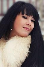 Ukrainian girl Ella,27 years old with brown eyes and black hair.