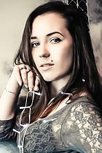 Ukrainian girl Vladislava,21 years old with grey eyes and dark brown hair.