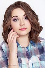 Ukrainian girl Tatyana,22 years old with blue eyes and light brown hair.