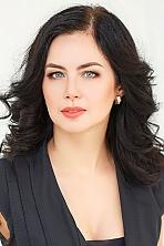 Ukrainian girl Oksana,43 years old with blue eyes and dark brown hair.