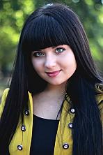 Ukrainian girl Yana,22 years old with green eyes and black hair.