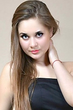 Russian girl Kseniya,26 years old with brown eyes and dark brown hair.