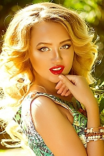 Ukrainian girl Olga,30 years old with hazel eyes and blonde hair.