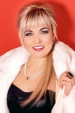 Ukrainian girl Ludmila,39 years old with blue eyes and blonde hair.