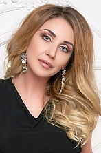 Ukrainian girl Irina,34 years old with grey eyes and light brown hair.