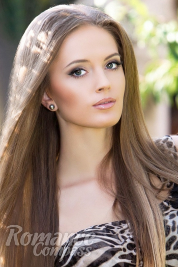 Ukrainian girl Ruslana,23 years old with green eyes and light brown hair.