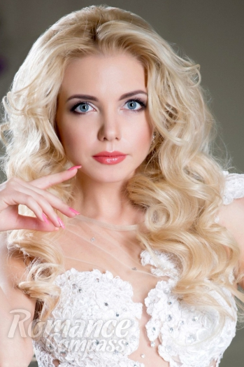 Ukrainian girl Axinia,27 years old with blue eyes and blonde hair.