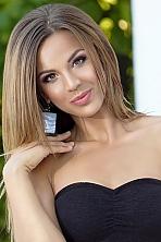 Ukrainian girl Olya,28 years old with brown eyes and dark brown hair.