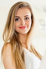 Ukrainian girl Mariya,22 years old with blue eyes and light brown hair.