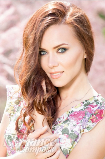 Ukrainian girl Viktoria,29 years old with blue eyes and dark brown hair.