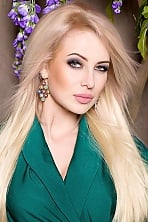 Ukrainian girl Alevtina,29 years old with green eyes and blonde hair.
